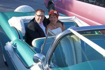 Blue Wedding Limo with couple in